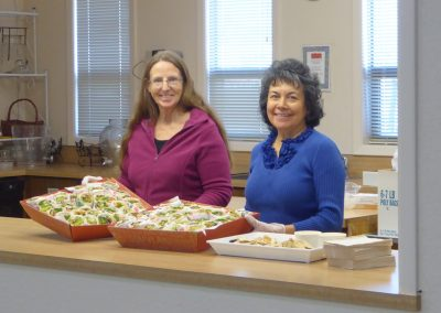 Volunteers serve wraps donated by Pita Pit.